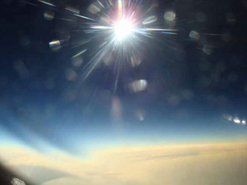 image taken 30 seconds before totality (the total phase) of the Aug. 1, 2008 solar eclipse, from the window of a jet flying over the Arctic Ocean