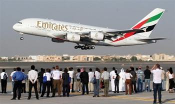 An Airbus A380 sporting the colors of Emirates, taking off during the Dubai Air Show