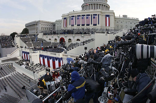 journalists take their positions around the Inauguration stand
