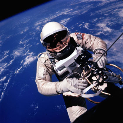 Ed White backs away from the Gemini spacecraft over the Pacific Ocean northeast of Hawaii