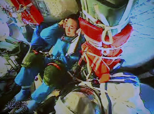 astronaut Jing Haipeng talks to the command and control center of Shenzhou VII