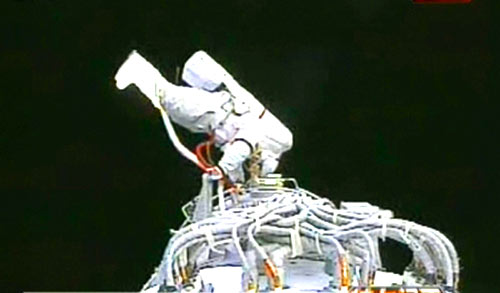 Chinese astronaut Zhai Zhigang conducts China's first spacewalk outside the Shenzhou VII spacecraft