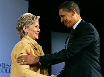 Sen. Hillary Rodham Clinton shakes hands with Sen. Barack Obama during a forum in Grantham