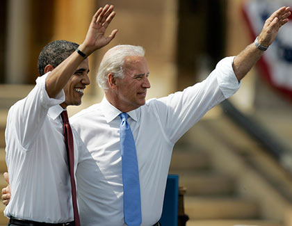 Democratic presidential candidate Sen. Barack Obama, D-Ill., and his vice presidential running mate Sen. Joe Biden, D-Del., wave to supporters outside the Old State Capitol on Saturday, Aug. 23, 2008, in Springfield, Ill.