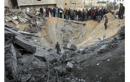 a bomb leaves a huge crater in the middle of the city