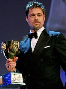 a stunned Brad Pitt picked up his best actor trophy that he was awarded for last year's The Assassination of Jesse James by the Coward Robert Ford