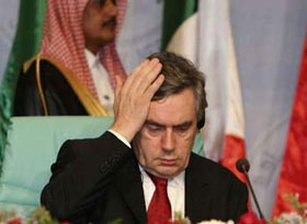 Britain's Prime Minister Gordon Brown listens to Saudi King Abdullah speech at the opening ceremony of the Jeddah Energy Meeting June 22, 2008