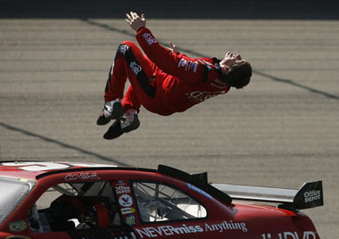 Carl Edwards does backflip off of his car after winning NASCAR Sprint Cup Auto Club 500 at Auto Club Speedway in Fontana, Calif.