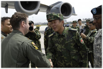 Senior Captain greets the first U.S. aircrews delivering earthquake relief supplies