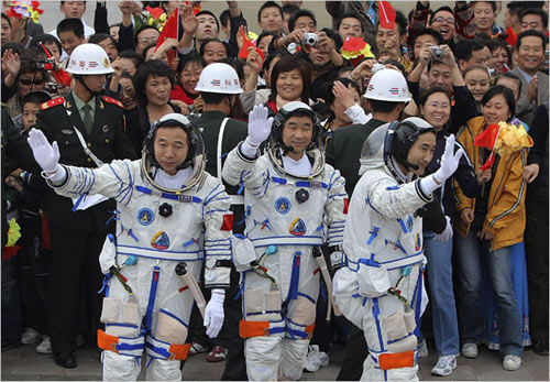 Chinese astronauts Jing Haipeng, Liu Boming and Zhai Zhigang during a ceremony before the launch of the Shenzhou 7 spacecraft at the Jiuquan Satellite Launch Center in northwest China's Gansu province on Thursday