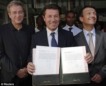 Nice mayor Christian Estrosi holds copies of Brangelina's new son Knox Leon Jolie-Pitt's birth certificate as Angelina's doctor Michel Sussman and hospital director Bernard Lecat look on