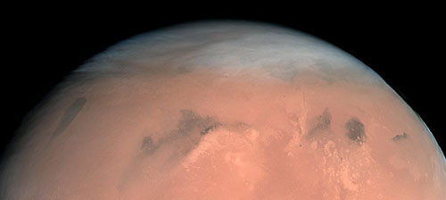 High, wispy clouds cover a large portion of Mars, seen in the first true-colour image of Mars generated with the OSIRIS orange (red), green and blue color filters