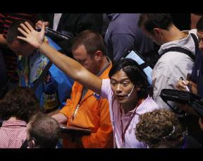 a trader gestures in the crude oil options pit at the New York Mercantile Exchange
