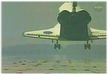 Discovery returns to earth after successful mission