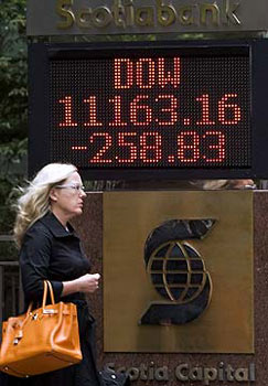 tote board tracking the level of the TSX in Toronto's financial district on Monday