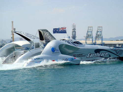 Biofuel-powered Earthrace has smashed the world circumnavigation record for a speedboat by almost 14 days