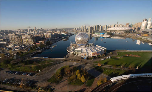 False Creek, with the 16-building Olympic Village to the left. At right is BC Place stadium where opening and closing ceremonies will take place. The Science World dome, center, was constructed for the 1986 World Exposition