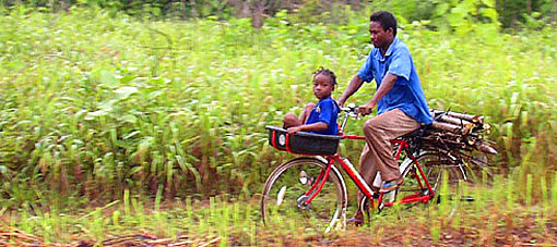 father and child on bike