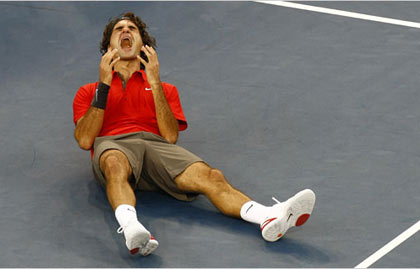 Roger Federer overcome with emotion after he defeated Andy Murray, 6-2, 7-5, 6-2, to win his 13th career Grand Slam title, one behind Pete Sampras's record