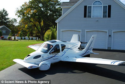 the Terrafugia Transition 'roadable' plane can be kept at home, with wings folded up, in your garage