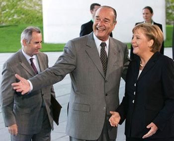 French President Jacques Chirac speaks with German Chancellor Angela Merkel upon his arrival at the Chancellery May 3, 2007 in Berlin, Germany. Chirac is on his last trip to Germany as French president; during his term in office he forged close relations between the two countries. Behind the two leaders stands a Franco-German joint military brigade