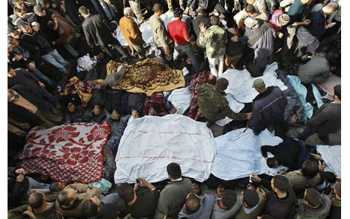 while the injured were taken to hospital, the dead were covered with sheets