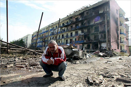 Georgian man amid the rubble of a destroyed street in the town of Gori. Georgian officials said that over the weekend Russia had expanded its attacks on Georgia, moving tanks and troops through South Ossetia and advancing toward the city of Gori in the center of the country.