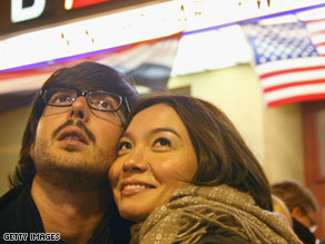 a German-speaking couple in Berlin watches the U.S. elections on TV late Tuesday night