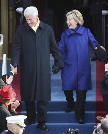 Secretary of State nominee Hillary Rodham Clinton and husband, the former President Bill Clinton, arrive at the Capitol in Washington