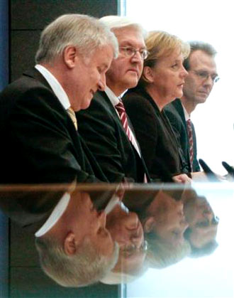 during a news conference in Berlin, from left, Christian Social Union Party chairman Horst Seehofer, Vice Chancellor and Foreign Minister Frank-Walter Steinmeier and German Chancellor Angela Merkel, and Peter Ehrlich, on Tuesday, Jan. 13, 2009, after the German coalition government agreed on a multibillion-euro economic stimulus package to help the country out of recession