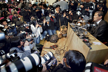 Humiliation: At a packed Dec. 16 press event, Hwang withdrew a key research paper
