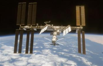 the International Space Station as seen from Space Shuttle Discovery as the two spacecraft begin their relative separation on Wednesday June 11, 2008