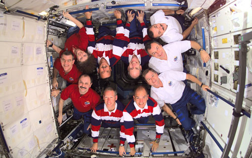 Expedition Three, STS-105 and Expedition crews assemble for a group photo in the Destiny laboratory on International Space Station