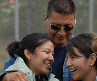 Johnny Nelson of Las Vegas hugs his daughters Erica and Alecia Wednesday afternoon at the Denali Park airstrip in Alaska