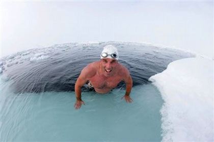 British explorer and endurance swimmer Lewis Gordon Pugh in the waters of the North Pole Sunday July 15, 2007. Pugh took to the freezing waters in just his Speedo swimming briefs, cap and goggles to highlight the devastating impact of climate change on the natural world. It took him 18 minutes and 50 seconds to swim 1 kilometre (0.6 miles) in waters created by melted sea ice at temperatures of minus 1.8C (29F)