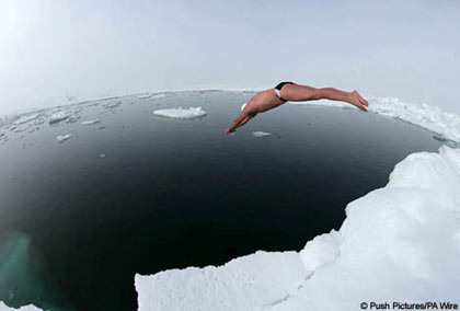Lewis dives into the icy water