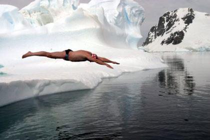 Lewis Gordon Pugh jumping off into freezing water