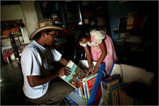Luis Soriano, of La Gloria, Colombia, created the Biblioburro in the belief that the act of taking books to people who do not have them can somehow improve this impoverished region. His daughter Susana, 7, helped prepare books to be loaded on the two donkeys, Alfa and Beto, who regularly trek with him to bring books to rural communities