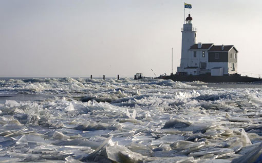 Marken lighthouse in northern Holland surrounded by ice sheets