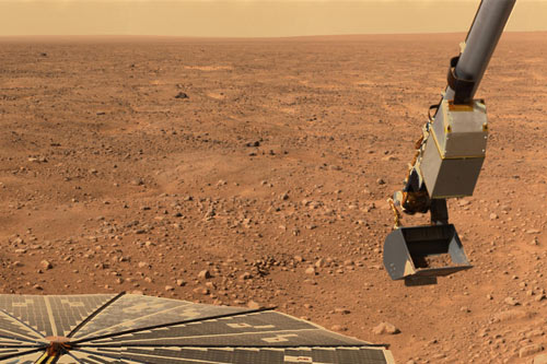 Mars' northern orange sky and horizon, seen by NASA's Phoenix Mars Lander, whose solar panel and Robotic Arm with a sample in the scoop are also visible