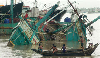 fishing boats crushed by tropical cyclone