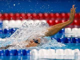 Natalie Coughlin swims the 100 meter backstroke en route to setting a new world record of 59.03 during the U.S. at the Swimming Olympic Trials on June 30, 2008 at the Qwest Center in Omaha, Nebraska