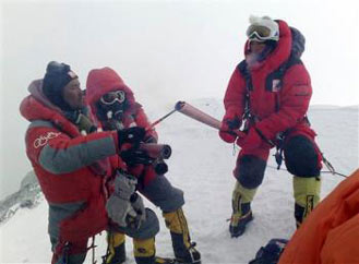 Olympic Torch lit on top of Mount Everest