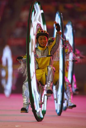 performers ride unicycle during the Closing Ceremony for the Beijing 2008 Olympic Games at the Beijing National Stadium on August 24, 2008