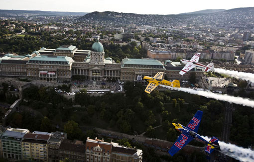 Hungarian pilot Peter Besenyei (bottom), Britain's Nigel Lamb and Paul Bonhomme (top) fly over Budapest, Hungary
