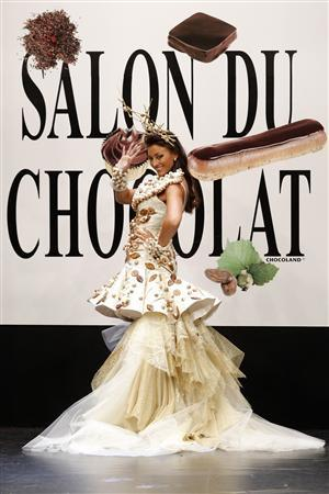 Former Miss France 2007 Rachel Legrain-Trapani presents a creation by Jean Doucet and Ghraoui Chocolatier at the 14th Salon du Chocolat (Paris Chocolate Show) in Paris October 28, 2008