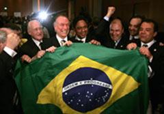 Rio de Janeiro bid team hoists their flag after the announcement