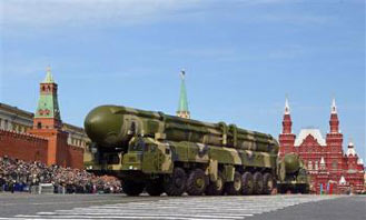 Russian truck-mounted Topol intercontinental ballistic missiles roll in the annual Victory Day parade