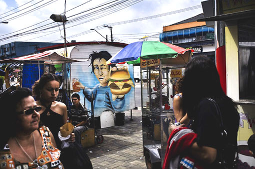 in the neighborhood Itaim Paulista, one of the poorer, outer districts of Sao Paulo, unsanctioned visual advertising can still be found on local vendor stands