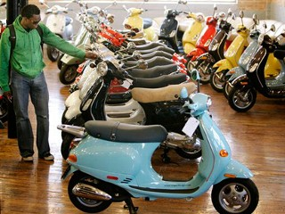 Local scooter shops are seeing an increase in sales after the rise of gas prices